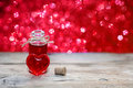 Open bottle of love potion Royalty Free Stock Photo