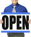Open for business a man in shirt and tie holding a signboard indicating Royalty Free Stock Image