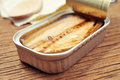 Open can of canned mackerel closeup an on a rustic wooden table Stock Photos