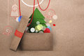 Open cardboard box with Christmas tree Royalty Free Stock Images