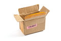 Open cardboard box with a label and barcode.