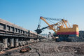 Open cast mine excavator loading iron ore into goods wagons in opencast Stock Photography