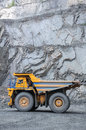Open cast mine picture of big yellow heavy truck in Stock Photos