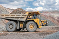Open cast mine picture of big yellow heavy truck in Stock Photo