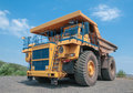 Open cast mine picture of big yellow heavy truck in Stock Images
