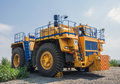 Open cast mine picture of big yellow heavy truck in Royalty Free Stock Photos