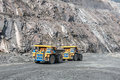 Open cast mine picture of big yellow heavy trucks in Stock Images