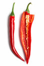 Open chillies chili peppers on white background Stock Photography