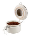 Open coffee canister with metal clamp the image is a cut out isolated on a white background a clipping path Stock Photography