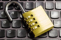 Open combination padlock on a laptop keyboard symbolizing data security computer and business Stock Photo