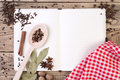 Open cookery book on wooden background Royalty Free Stock Image