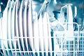 Open dishwasher clean dishes in close up Royalty Free Stock Photo