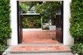 Open door with garden view Royalty Free Stock Photo
