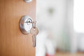 Open door with keys, key in keyhole Royalty Free Stock Photo