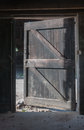 Open door in a neglected barn Royalty Free Stock Photo