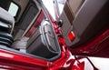 Open door of red semi truck with luxury brown interior