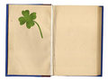 Open Empty Book With Four-Leaf Clover Stock Photo