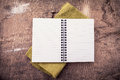 Open empty notebook on wooden background