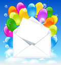 Open envelope with colorful balloons and letter in the clouds sky Stock Image