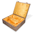 Open fabric covered oriental box Stock Photography