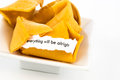 Open fortune cookie everything will be alright with strip of white paper Royalty Free Stock Photo
