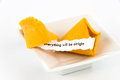 Open fortune cookie everything will be alright with strip of white paper Royalty Free Stock Photos