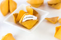 Open fortune cookie you will conquer with strip of white paper Stock Image