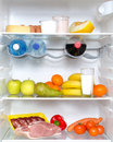 Open fridge full of fruits and meat Royalty Free Stock Image