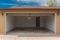 Open garage door under blue sky Royalty Free Stock Photo