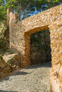 Open gateway the through the ancient bricked wall of a medieval fortress tossa de mar spain Stock Photos