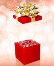 Open gift box surprise red with sparkles Stock Photo