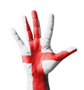 Open hand raised multi purpose concept england flag painted isolated on white background Royalty Free Stock Photos