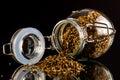 Open jar of oregano Royalty Free Stock Photo