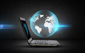 Open laptop computer with globe projection Royalty Free Stock Photo