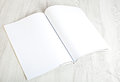 Open magazine with blank pages on white table Stock Photography