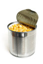 Open metallic can with sweet corn on a white background Royalty Free Stock Photo