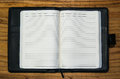 Open note book diary empty pages with black leather case Royalty Free Stock Photo