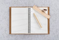 Open note book with pen, wooden ruler and pencil sharpener. Royalty Free Stock Photo
