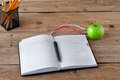 Open notebook with blank pages, pen and green apple Royalty Free Stock Photo