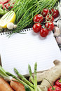 Open notebook and fresh vegetables Royalty Free Stock Photo