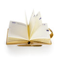 Open notebook with gold pen on white background Royalty Free Stock Image