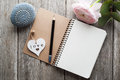 Open notebook, heart, paperweight Royalty Free Stock Photo