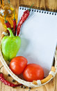 Open notebook with vegetables in the basket Royalty Free Stock Photos