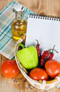 Open notebook with vegetables in the basket Stock Photos