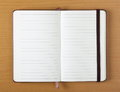 Open notebook on wood background or journal with blank lined pages for copy space a plain Royalty Free Stock Image