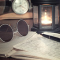 An open old book by the candlelight Stock Photography