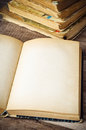 Open old book wooden surface Royalty Free Stock Image