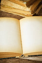 Open old book wooden surface Royalty Free Stock Images