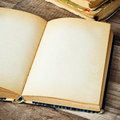 Open old book wooden surface Stock Photo