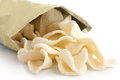 Open packet of prawn crackers on white Stock Photography
